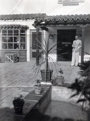 Tony Burke in front of his art gallery at the El Paseo Building, circa 1930.
