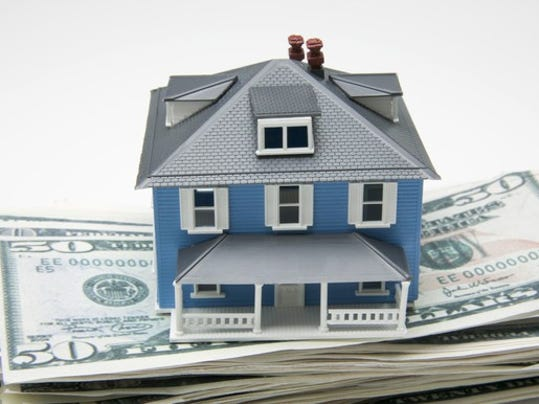 getty-house-on-money_large.jpg