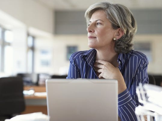 mature-woman-on-laptop-thinking-and-looking-out-window-1_large.jpg