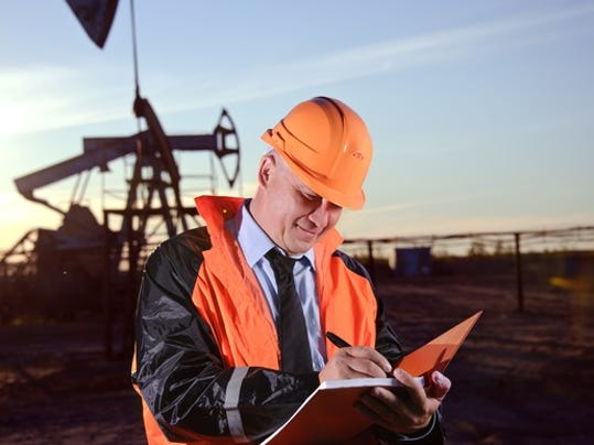 16_06_15-man-with-notebook-in-front-of-oil-well_xom_bp_tot_e_rdsb_cvx_gettyimages-156525694_large.jpg