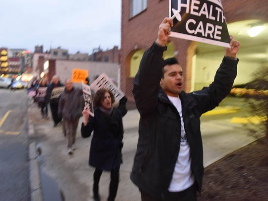 Health care advocates rallying Wednesday in Morristown against repeal of the ACA.