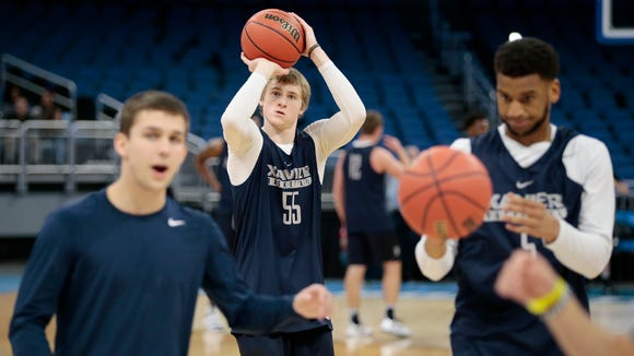 Xavier Musketeers guard J.P. Macura (55) shoots from behind the arc during a practice session at the Amway Center in Orlando, Fla., on Wednesday, March 15, 2017.