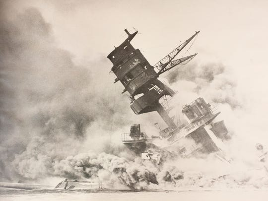 The USS Arizona burns after being struck by an armor-piercing bomb Dec. 7.