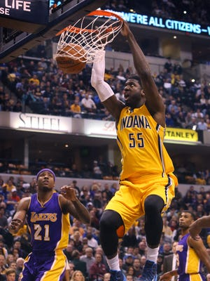 Indiana Pacers center Roy Hibbert slam-dunks the ball in front of Los Angeles Lakers player Ed Davis at Bankers Life Fieldhouse on Monday, Dec. 15, 2014.