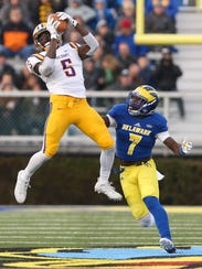 Albany's Jerod Diggs (left) takes in a pass as Delaware's