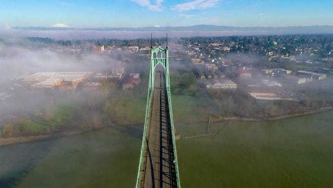 The St. Johns bridge was designed by David Steinman and completed in 1931. Today, the bridge is painted ODOT Green, but it was initially supposed to be black with yellow stripes.
