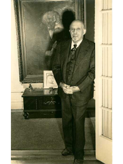 A photo of W.E.B. Du Bois at home around 1946, standing