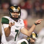 CSU quarterback Nick Stevens (7) calls a play against Fresno State during the Rams 34-31 win Saturday.