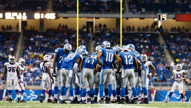 The Detroit Lions huddle against the Buffalo Bills at Ford Field in Detroit on Sept. 3, 2015.
