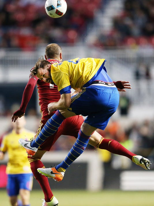 Colorado Rapids defender Bobby Burling, right, and Real Salt Lake forward Yura Movsisyan go for a head ball during an MLS soccer match Saturday, April 9, 2016, in Sandy, Utah. (Jeffrey D. Allread/Deseret News via AP)