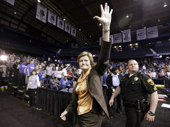 In this March 19, 2012, file photo, Tennessee head coach Pat Summitt waves as she leaves the court after Tennessee defeated DePaul 63-48 in an NCAA tournament second-round women's college basketball game in Rosemont, Ill. Summitt, the winningest coach in Division I college basketball history who uplifted the women's game from obscurity to national prominence during her career at Tennessee, died Tuesday morning, June 28, 2016. She was 64.