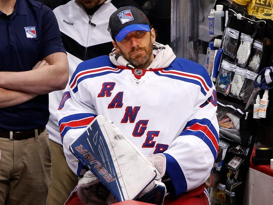 New York Rangers goalie Henrik Lundqvist sits on the bench during the third period after being pulled during game 5 in a first-round NHL playoff hockey game against the Pittsburgh Penguins in Pittsburgh, Saturday, April 23, 2016. The Penguins won 6-3, to clinch the best-of-seven games series 4-1. (AP Photo/Gene J. Puskar)