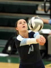Mount Notre Dame's Margo Wolf gets a dig during a Cougars
