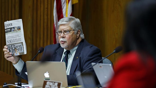 Springfield Mayor Bob Stephens holds up a past edition of the Springfield News-Leader as he made a speech during Monday's City Council meeting. Stephens was speaking prior to a council vote on whether to implement a stricter indecent exposure law.