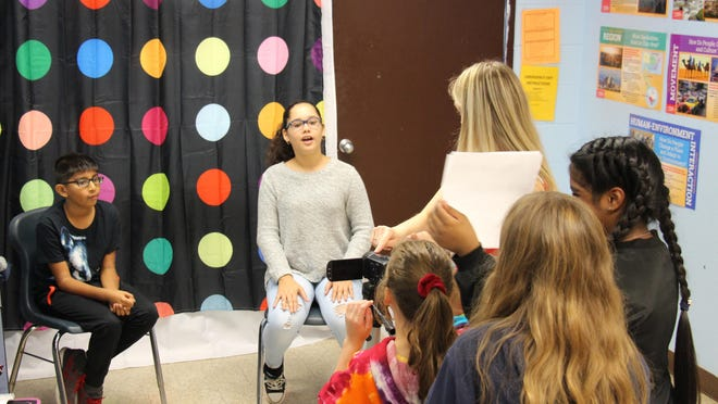 Circleville Middle School students hold cue cards and others film while one student interviews another about how to make the school a more inclusive community. Their video project won second place in a national Sandy Hook Promise contest.