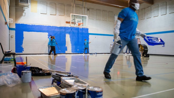 Goodyear employees volunteer their time in 2020 as they repaint the gymnasium at the Boys and Girls Clubs of Topeka's Teen Center, 1112 S.E.10th Ave. Volunteering is just one of the ways the community can participate in United Way of Greater Topeka's Day of Giving.