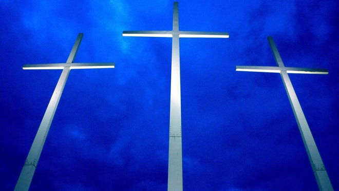 February 17, 2011 - The three giant crosses, belonging to Bellevue Baptist Church,  stand at I-40 and Appling Rd. in Cordova. It is hard to miss the crosses or the church which sits on a 377 acre campus and has a sanctuary that seats 7,000 people. The center cross is 150 feet tall,  and is flanked by two 120-foot crosses.  (Karen Pulfer Focht/The Commercial Appeal)