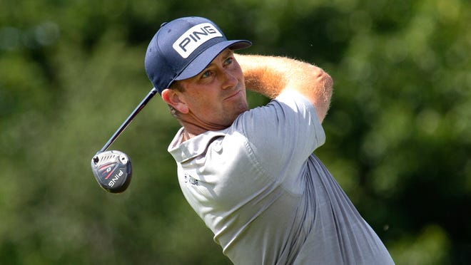Michael Thompson watches his tee shot on the 14th hole during the final round of the 3M Open.