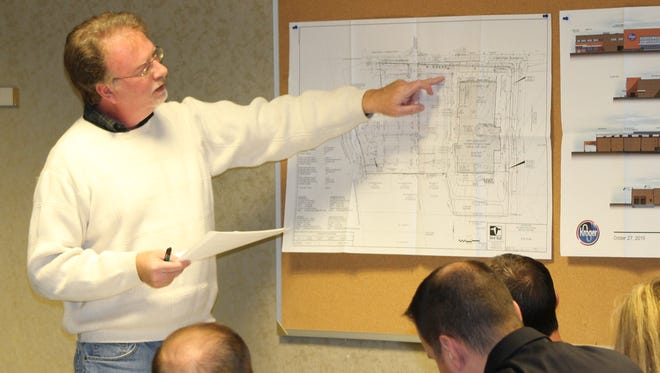 Dan Stewart, assistant director of land development and information for the Marion County Planning Commission, discusses the site plan for a new business during a January 2016 meeting. Stewart died earlier this month.