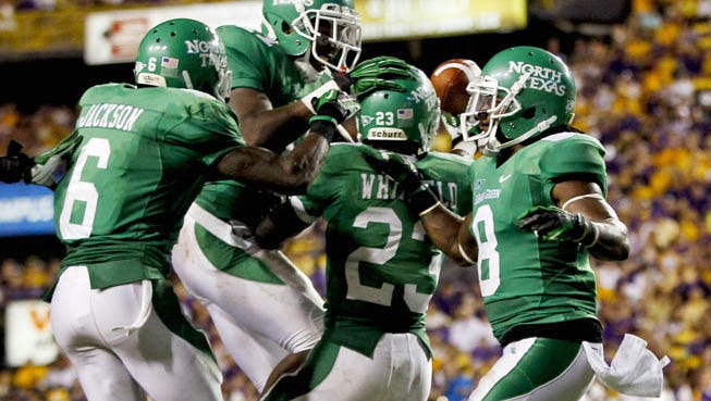 North Texas celebrated after upsetting UTSA 30-23 for its first win of the season.
