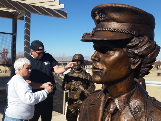 Karen Woods, left, president of the United Military Women of the SouthWest, directs artist Matt Glenn on Wednesday as to where to place six statues of military women at a new memorial in Las Cruces Veterans Memorial Park, 2651 Roadrunner Parkway.