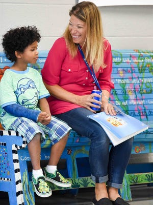 Kindergartener Jace Dean explains to Teacher Stephanie Jacks that he broke his arm when he and his Great Grandmother were playing on the monkey bars, on Wednesday, August 26, 2015, during the first day of school at Timber Ridge Elementary.