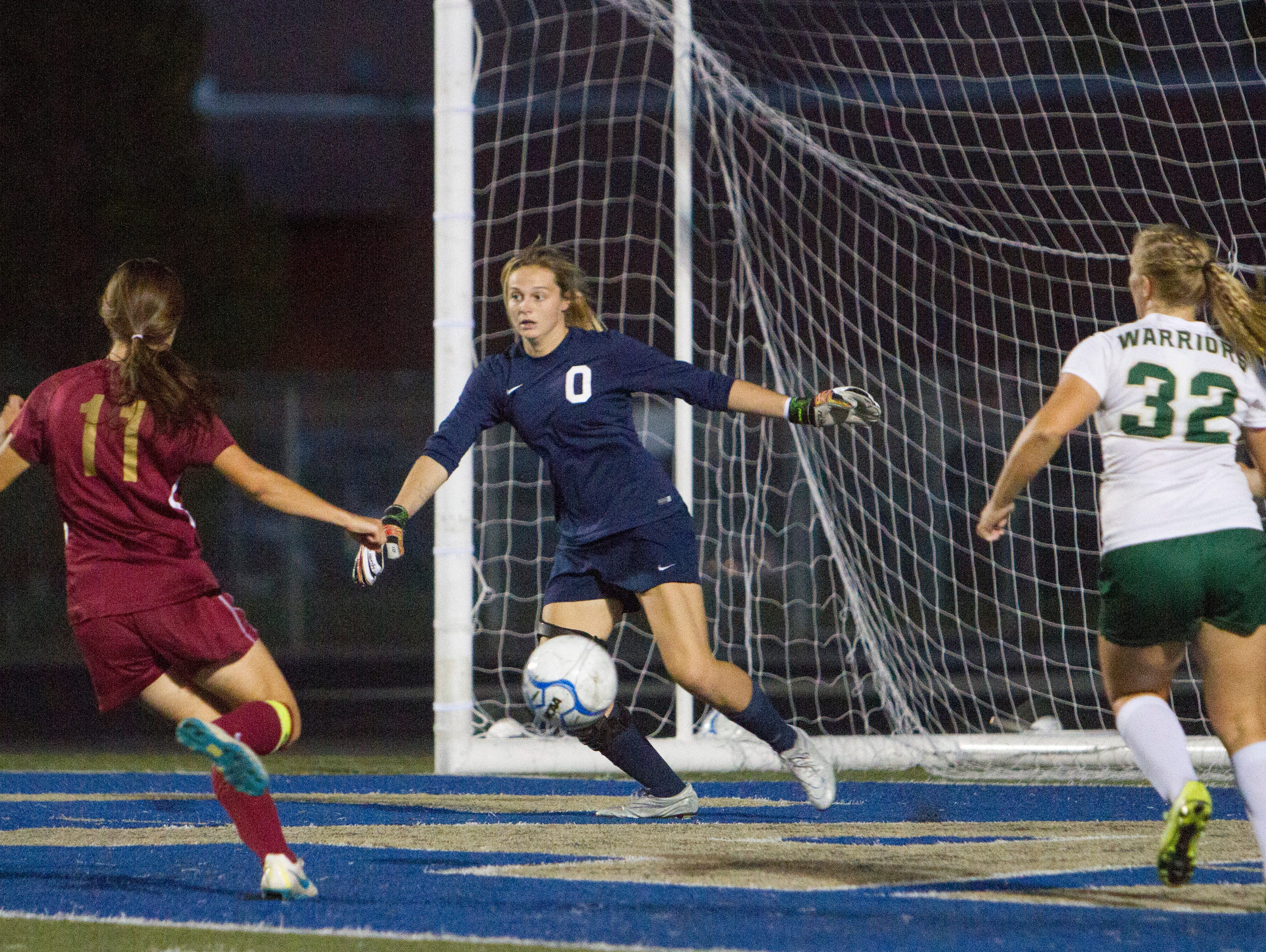 Snow Canyon goalie Madison Mooring makes a save during their game against Cedar High Tuesday, Sept. 29, 2015.