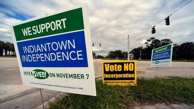 Signs posted along Southwest Warfield Boulevard encourage Indiantown residents to vote Nov. 2, 2017, for or against Indiantown becoming an unincorporated village from Martin County.