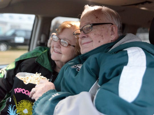 Walter and Sally Kappeler, of Gibbsboro, cuddle in their car at the Delsea Drive-In in Vineland on Saturday, November 8, 2014.