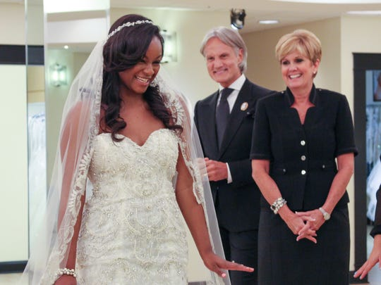 Taylor tries on a wedding dress with Monte Durham, Lori Allen and an assistant in 'Say Yes to the Dress: Atlanta.'