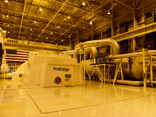 Main turbine room at Davis–Besse Nuclear Power Station contains four large valves and the plant's main generator.
