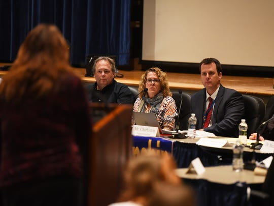 The school board and Superintendent of Schools Brett Charleston listen as Patty Walker, Social Studies teacher asks a question about the reconfiguration of the district's elementary grades at some of its Board of Education meeting at Pequannock Township High School in Pequannock on March 27, 21017.