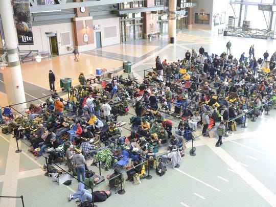 Green Bay Packers fans line up early to get Aaron Rodgers autographs on Dec. 18, 2017, in the Lambeau Field Atrium. Rodgers signed 200 autographs to raise money for Salvation Army. The queue was full by early morning.
