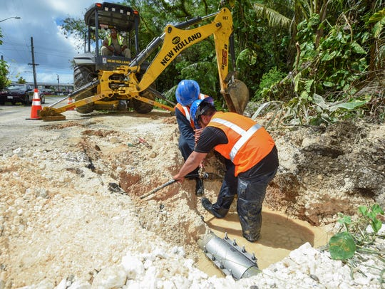 In this April 4 file photo, Guam Waterworks Authority employees conduct repairs to a waterline along Asardas Drive in Yigo.