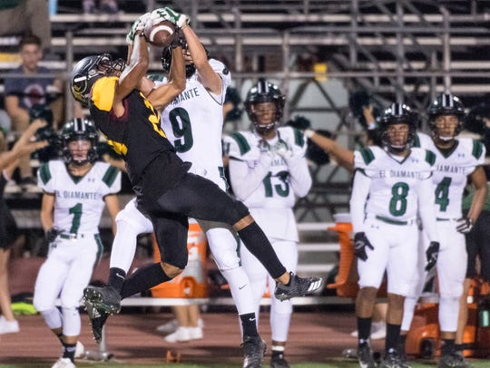 Tulare Union's Randy Jordan Jr. intercepts a pass intended