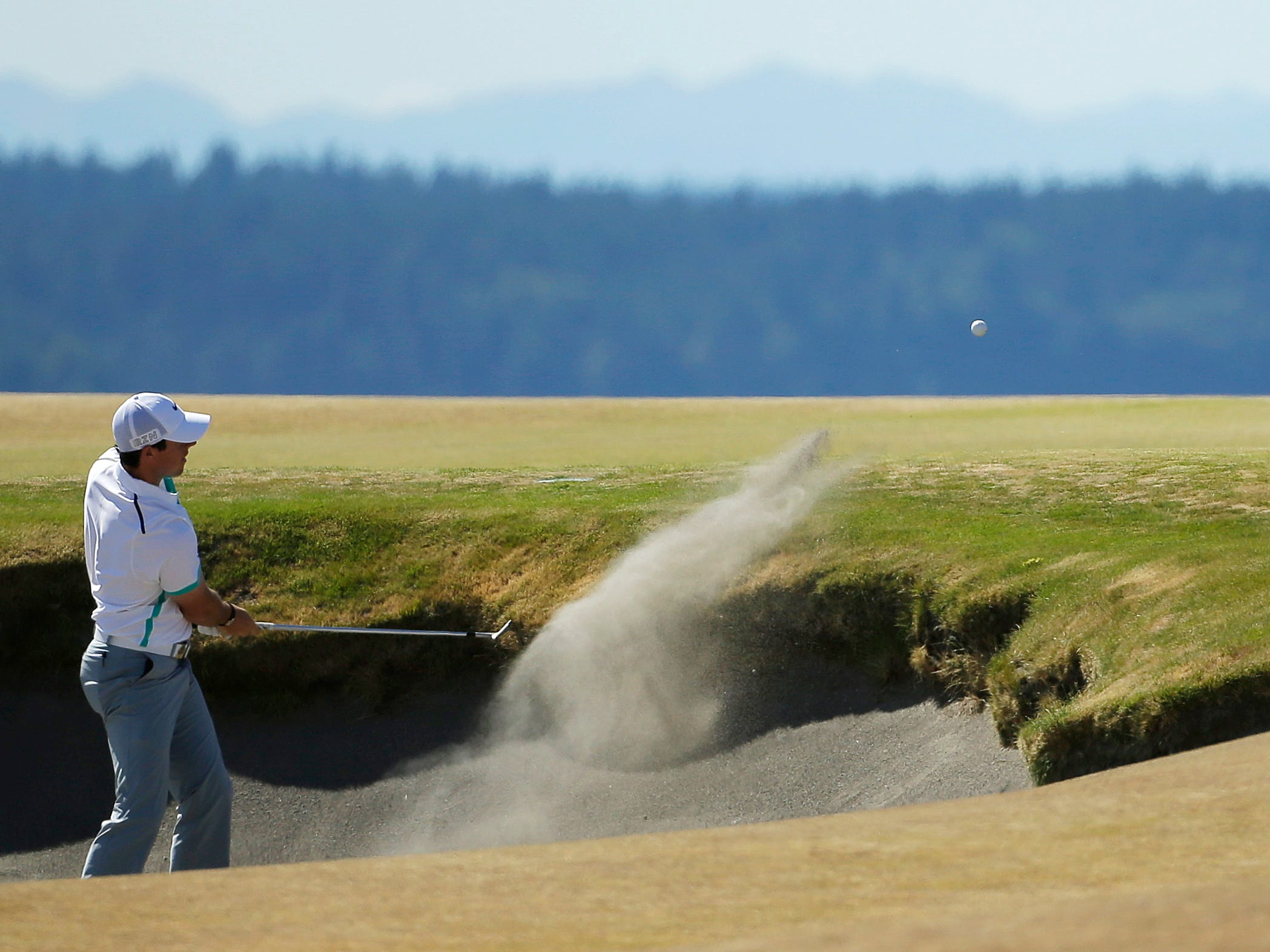 Rory McIlroy, of Northern Ireland, hits out of the bunker on the fifth hole during the second round of the U.S. Open golf tournament at Chambers Bay on Friday, June 19, 2015 in University Place, Wash. (AP Photo/Ted S. Warren)