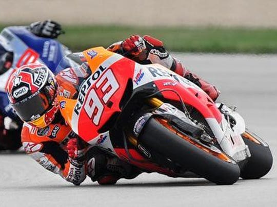 Rider and points leader Marc Marquez leads Jorge Lorenzeo, middle, and teammate Dani Pedrosa into turn 11 after taking the lead the 2013 Moto GP held at the Indianapolis Motor Speedway on Sunday, August 18, 2013.