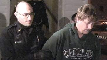Scott Pescara is escorted out of Sweden Town Court Jan. 9, 2010. (CHAD ROBERTS staff photographer)