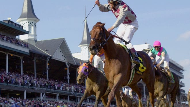 FILE ** Jockey Jose Santos celebrates aboard Funny Cide after crossing the finish line to win the 129th running of the Kentucky Derby at Churchill Downs, in this May 3, 2003 file photo in Louisville, Ky. (AP Photo/Al Behrman)