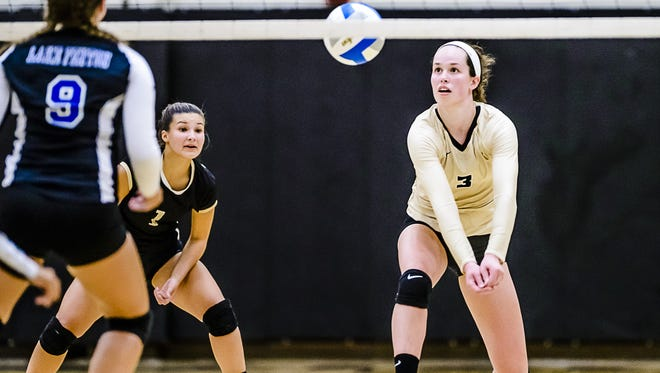 Meredith Norris, right, of Corunna was named Michigan's Miss Volleyball Monday.