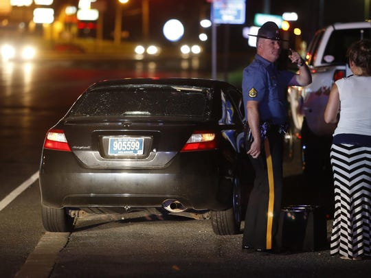 A car with a crumpled front and broken rear windshield rests at the scene as Delaware State Police investigate after a pedestrian was struck by a car on Kirkwood Highway in front of Bull's Eye Saloon and Restaurant shortly after 10 p.m. Wednesday.