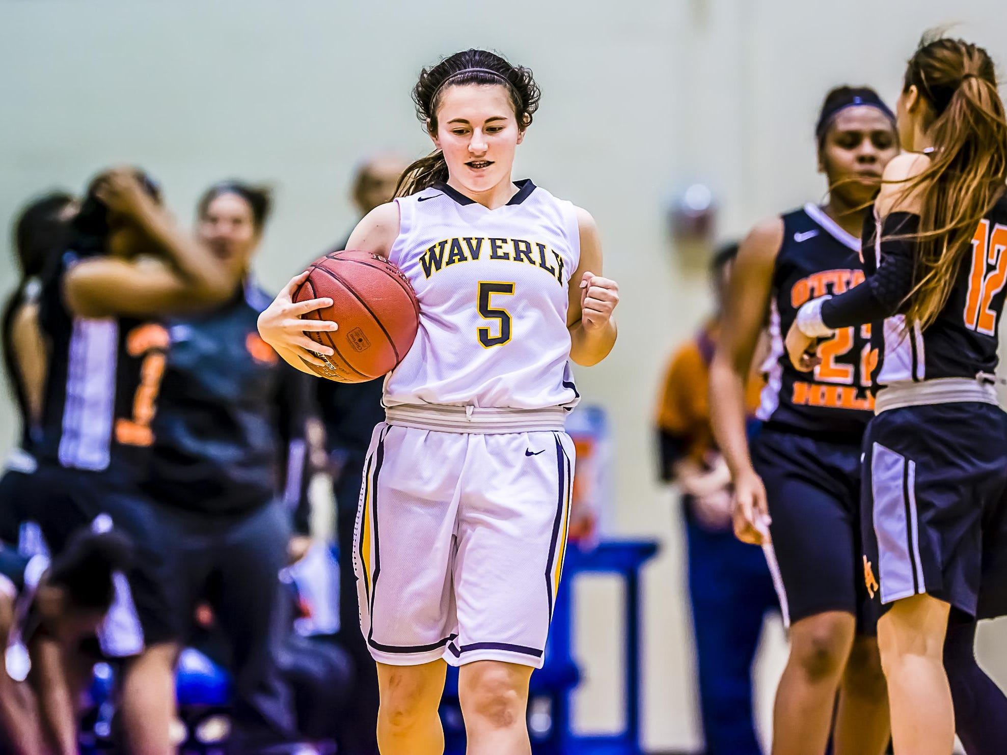 Sarah Miller of Waverly celebrates as time expires in the Warriors' 39-37 win over Ottawa Hills in their Holiday Hoops Invitational game Tuesday December 29, 2015 at Lansing Community College. KEVIN W. FOWLER PHOTO