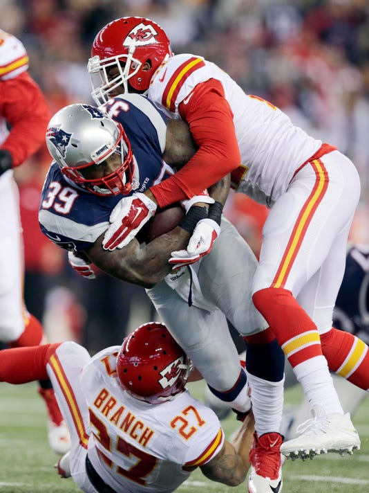 Kansas City Chiefs cornerback Sean Smith (21) and defensive back Tyvon Branch (27) tackle New England Patriots running back Steven Jackson (39) in the first half of an NFL divisional playoff football game, Saturday, Jan. 16, 2016, in Foxborough, Mass. (AP Photo/Charles Krupa)