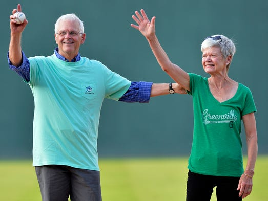 To help celebrate the City of Greenville's 183rd birthday, the Greenville Drive held their annual Green Day. This year's honorees Hayne and Anna Kate Hipp wave to the crowd before throwing out the first pitch before the Drive took the field against the Augusta GreenJackets at Fluor Field in Greenville on Tuesday, August 5, 2014.