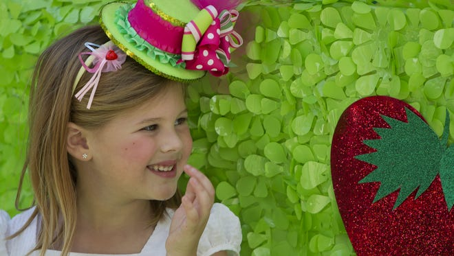 "Makenna Bell, 5, smiles as her ""So Berry Sweet"" Tea Party float rides in the Edison Festival of Light Junior Parade in Fort Myers in 2013."