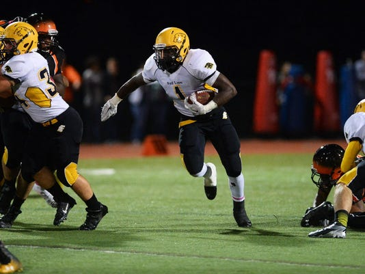 Red Lion's Antwan Jackson makes a run during the football game last week at Central York. The Lions' 20-13 win added to the potential suspense in the YAIAA Division I chase for the final two weeks.