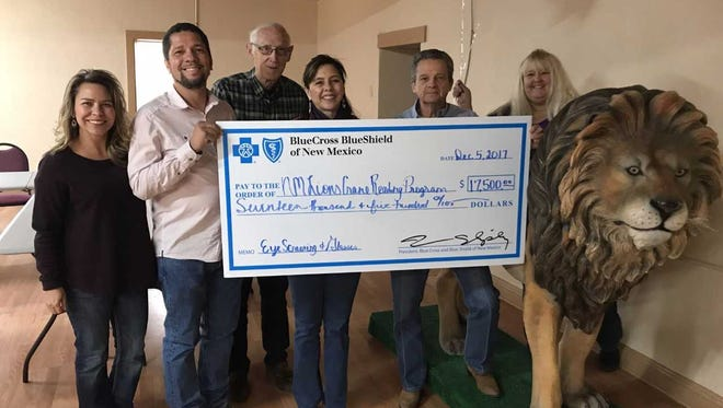 The New Mexico Lions Crane Reading Program, in Las Cruces, was surprised with a $17,500 grant from Blue Cross and Blue Shield of New Mexico on Tuesday, Dec. 5, 2017. The grant will support eye screenings and eye glasses for needy children. From left, Consuelo Cowder, BCBSNM; Thomas Butler, BCBSNM; George Mulholland, Lions Crane; Christine Rocha, BCBSNM: Bryson McCool, Lions Crane; and Brenda Dunn, Lions Crane.