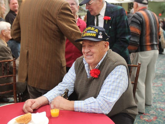 Tony Rabasaco, 90, sits down at the luncheon on Sunday.