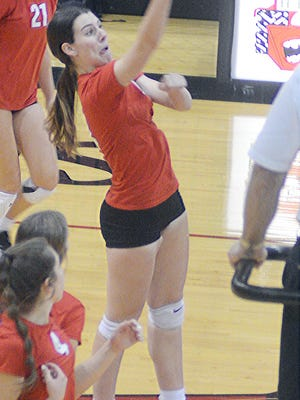 Hesston junior Katie Kueker spikes the ball during play Tuesday in a home triangular. The Swathers ended the regular season with a sweep.