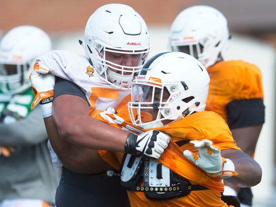 At left Tennessee offensive lineman Riley Locklear